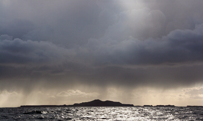 squall over the treshnish isles by richard crossen