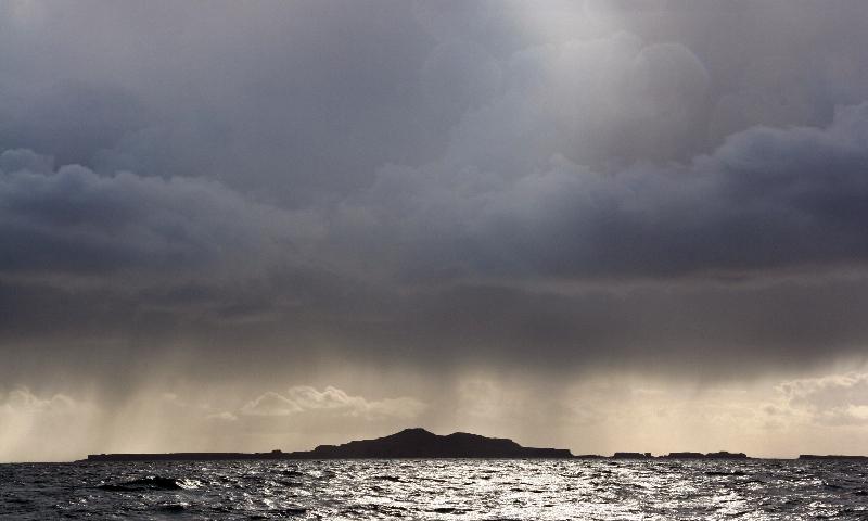 squall over the treshnish isles by richard crossen
