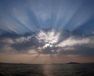 sun setting over the treshnish isles - eddie paterson